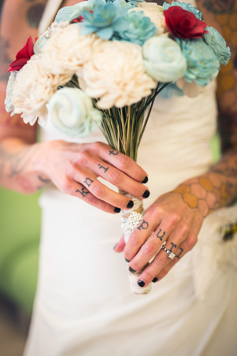 tattooed feminist elopement nyc inger holding bouquet