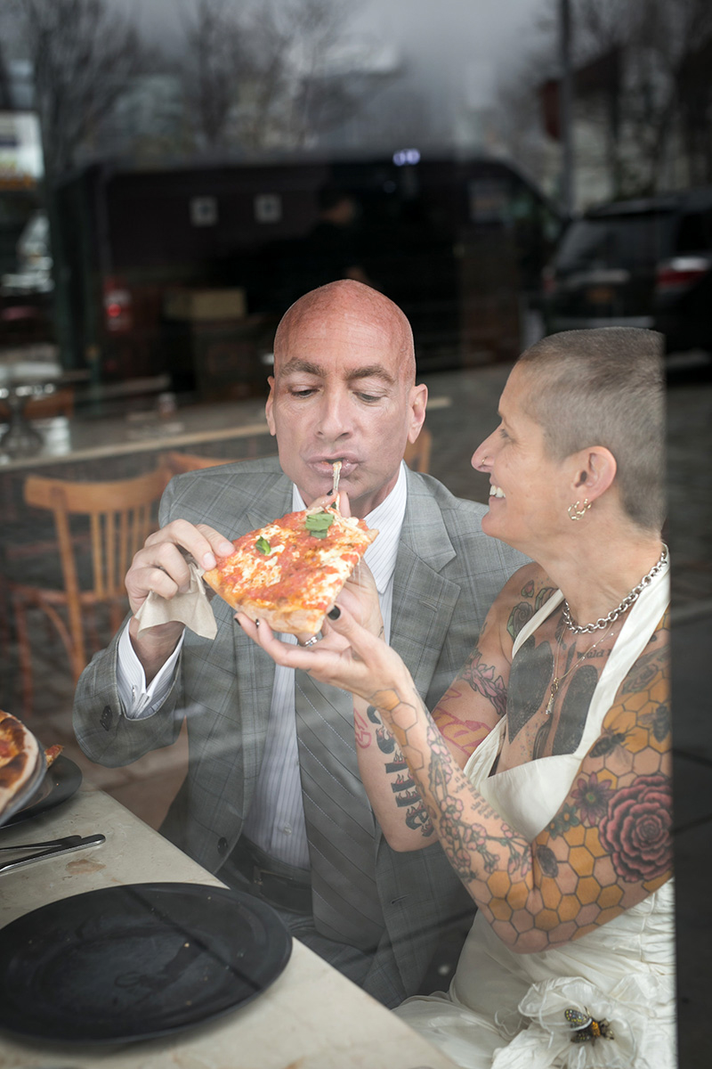 tattooed feminist elopement nyc frank and inger having pizza