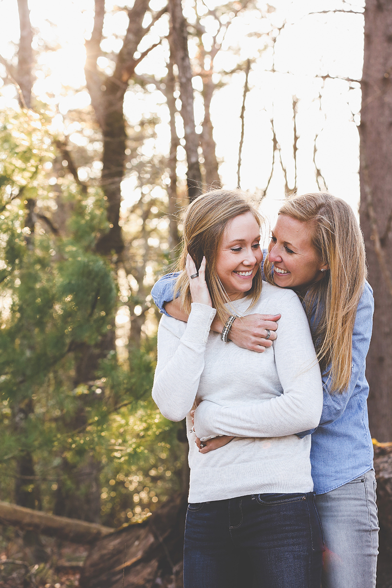 mt. airy north carolina natural engagement ashley and ruthie embrace in woods