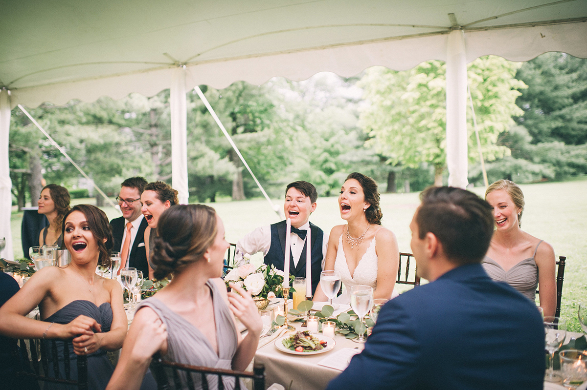 Garden wedding louisville kentucky wedding party table laughing