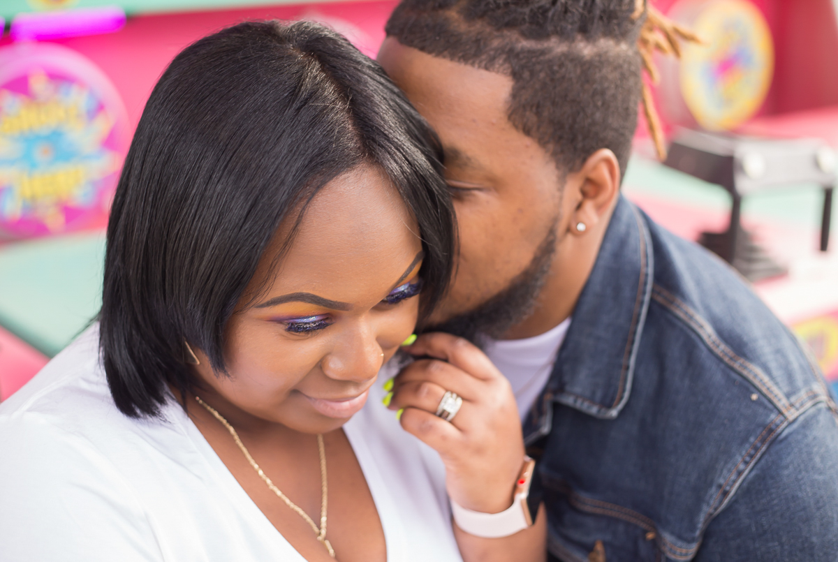 CARNIVAL PHOTO SESSION DURHAM NORTH CAROLINA DEON WHISPERING SOMETHING IN BRITTANY'S EAR
