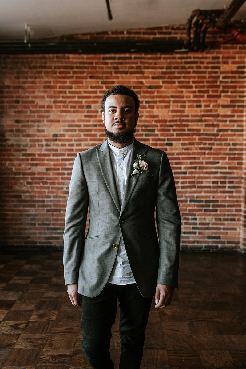 baltimore photo shoot portrait shot of dymir with brick wall in background