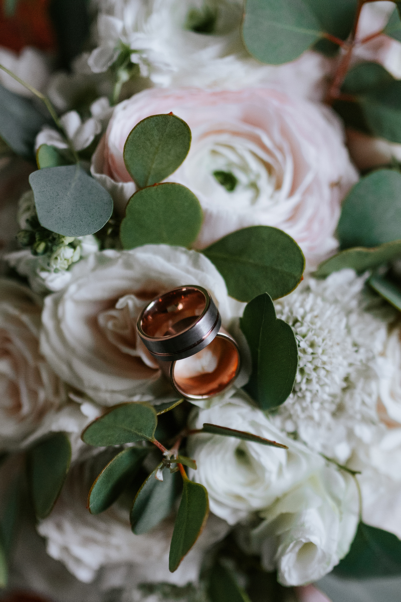 baltimore photo shoot wedding bands resting on bouquet