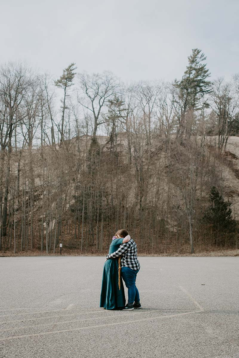 Emily and Ang Beach Wedding Engagement Session at Hoffmaster State Park on Lake Michigan by Liv Lyzsyk Photography