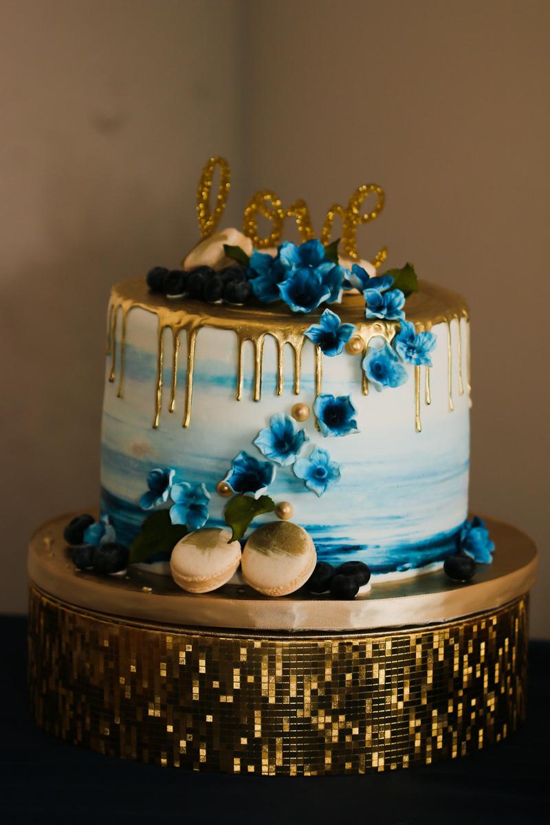 rialto theatre wedding cake on gold tray