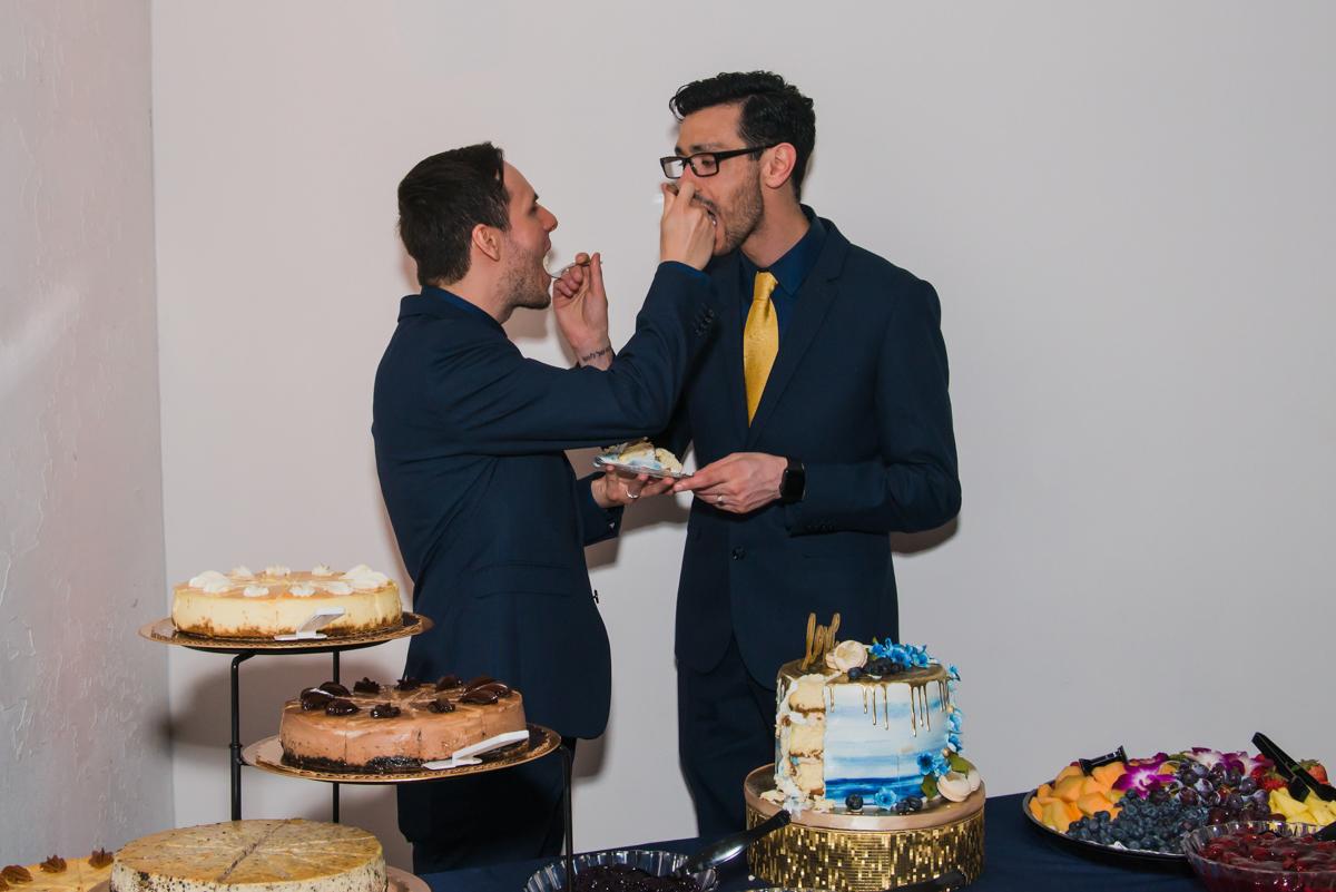 rialto theatre wedding couple feeding each other cake