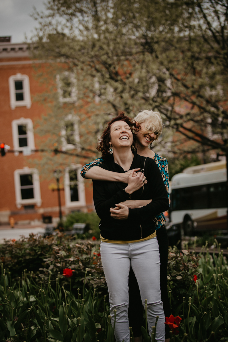 BALTIMORE COFFEE SHOP ENGAGEMENT SESSION EMBRACE IN GARDEN