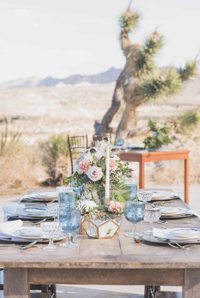 multi-cultural desert elopement table settings with joshua tree and desert in background