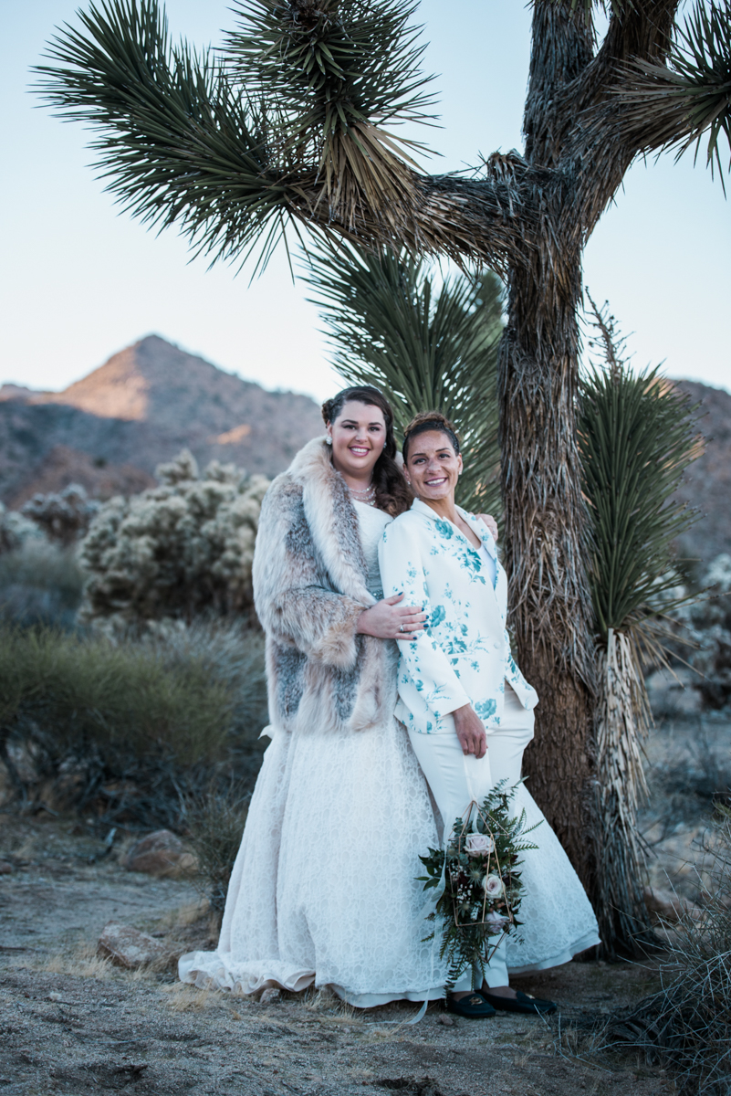 multi-cultural desert elopement pose by tree