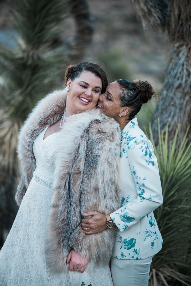 multi-cultural desert elopement embrace from behind