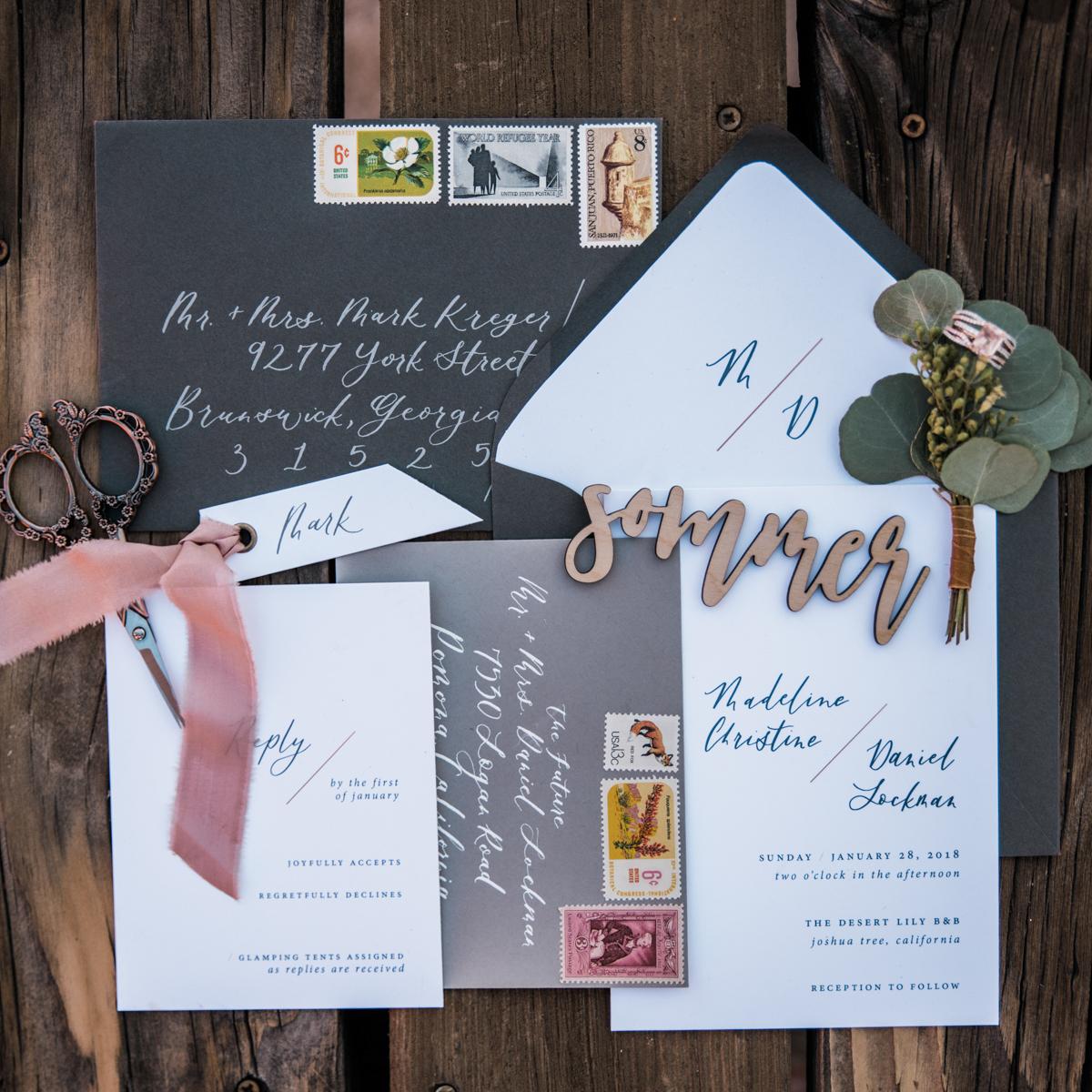 multi-cultural desert elopement invitations and envelopes with decorative scissors