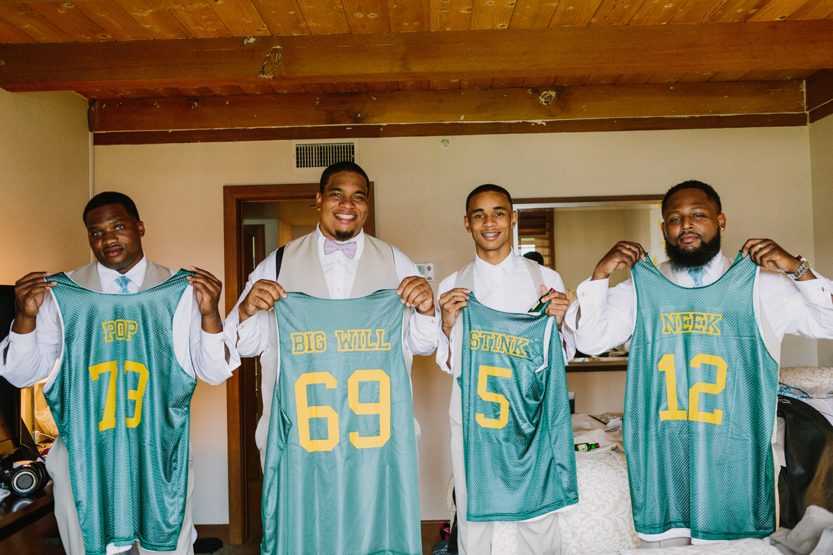 San Diego Tropical-Inspired Wedding william and groomsmen holding up custom jerseys