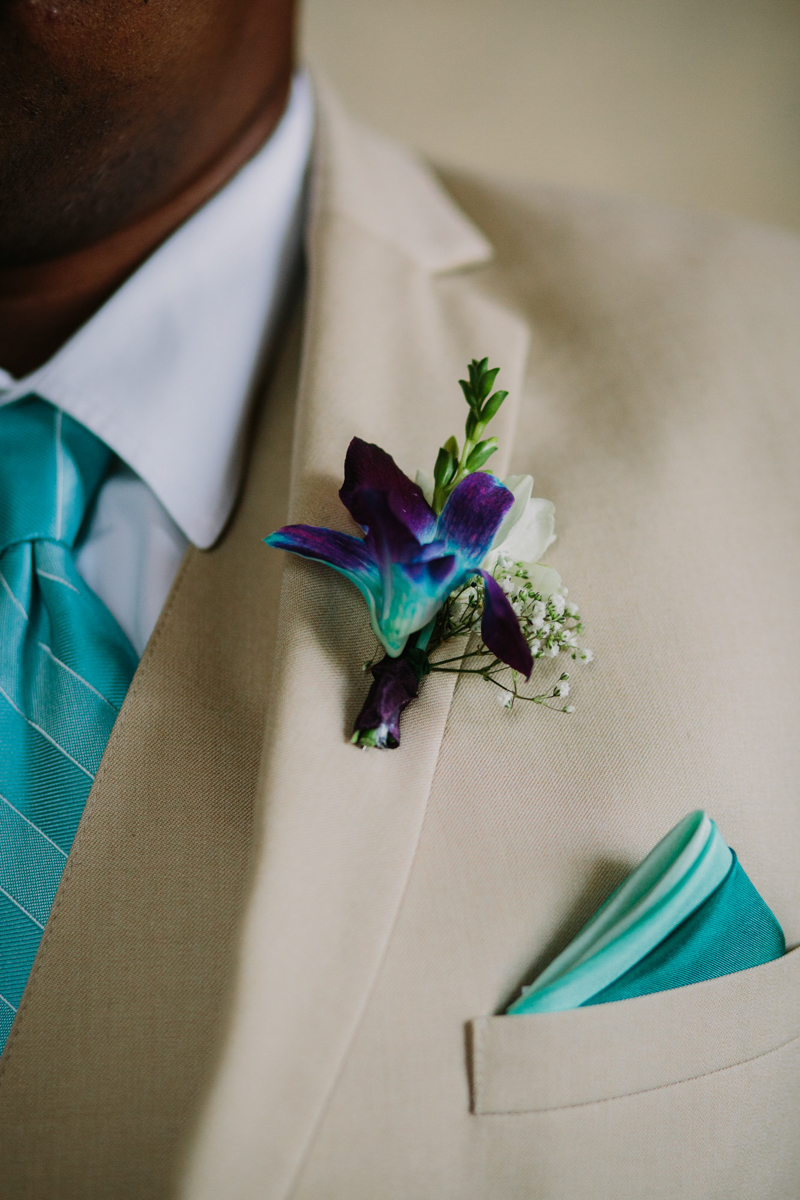 San Diego Tropical-Inspired Wedding close up of william's flower lapel and pocket square