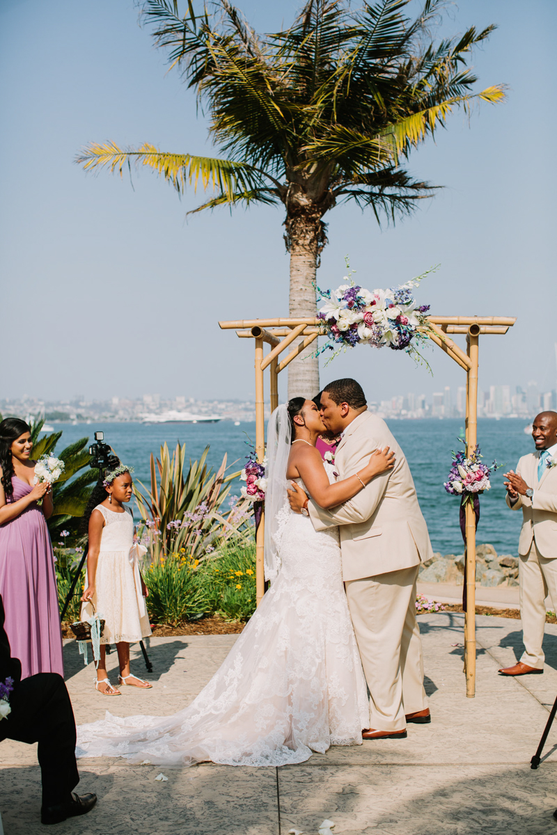 San Diego Tropical-Inspired Wedding ceremony kiss