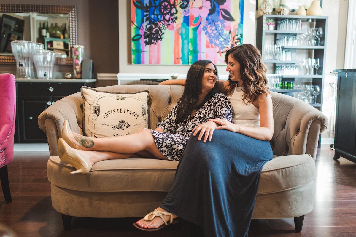 Wine Bar Engagement Virginia Carmen and Natalie on sofa