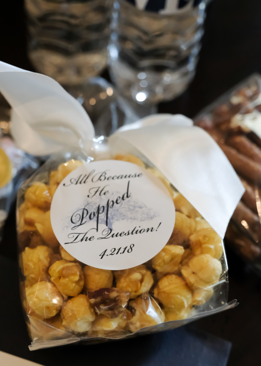 "Classic southern style wedding savannah georgia bag of caramel popcorn as guest wedding favor with sticker reading ""all because he popped the question! 4.21.18"""