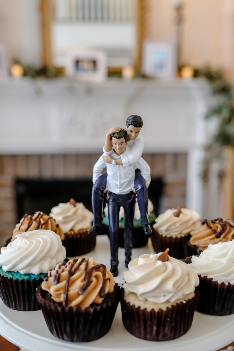 "Classic southern style wedding savannah georgia cupcake tower with ""topper"" of one groom carrying the other oh his back"