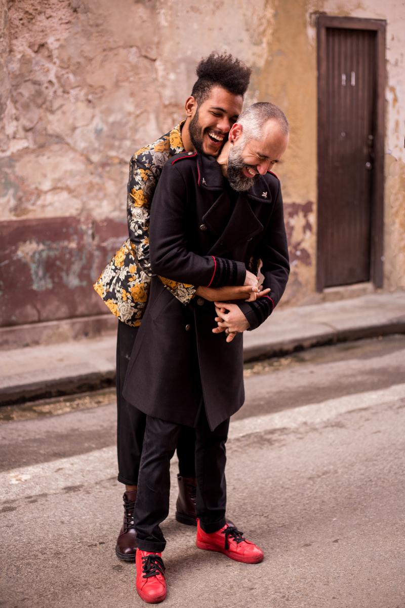 lovers in havana felix hugging ishak from behind, both laughing