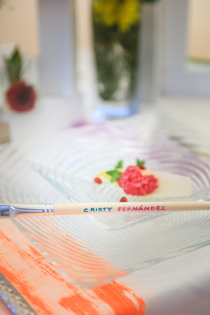 """Love Out Loud Parker Colorado Styled Shoot entrée with paintbrush reading """"cristy fernandez"""" for guest seating"""