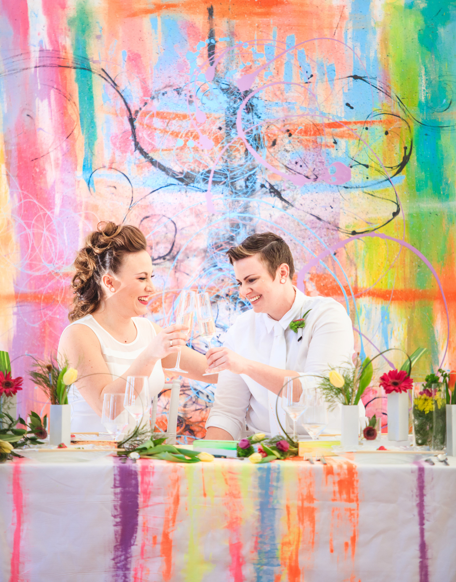 """Love Out Loud Parker Colorado Styled Shoot couple tapping champagne glasses together for """"cheers"""""""