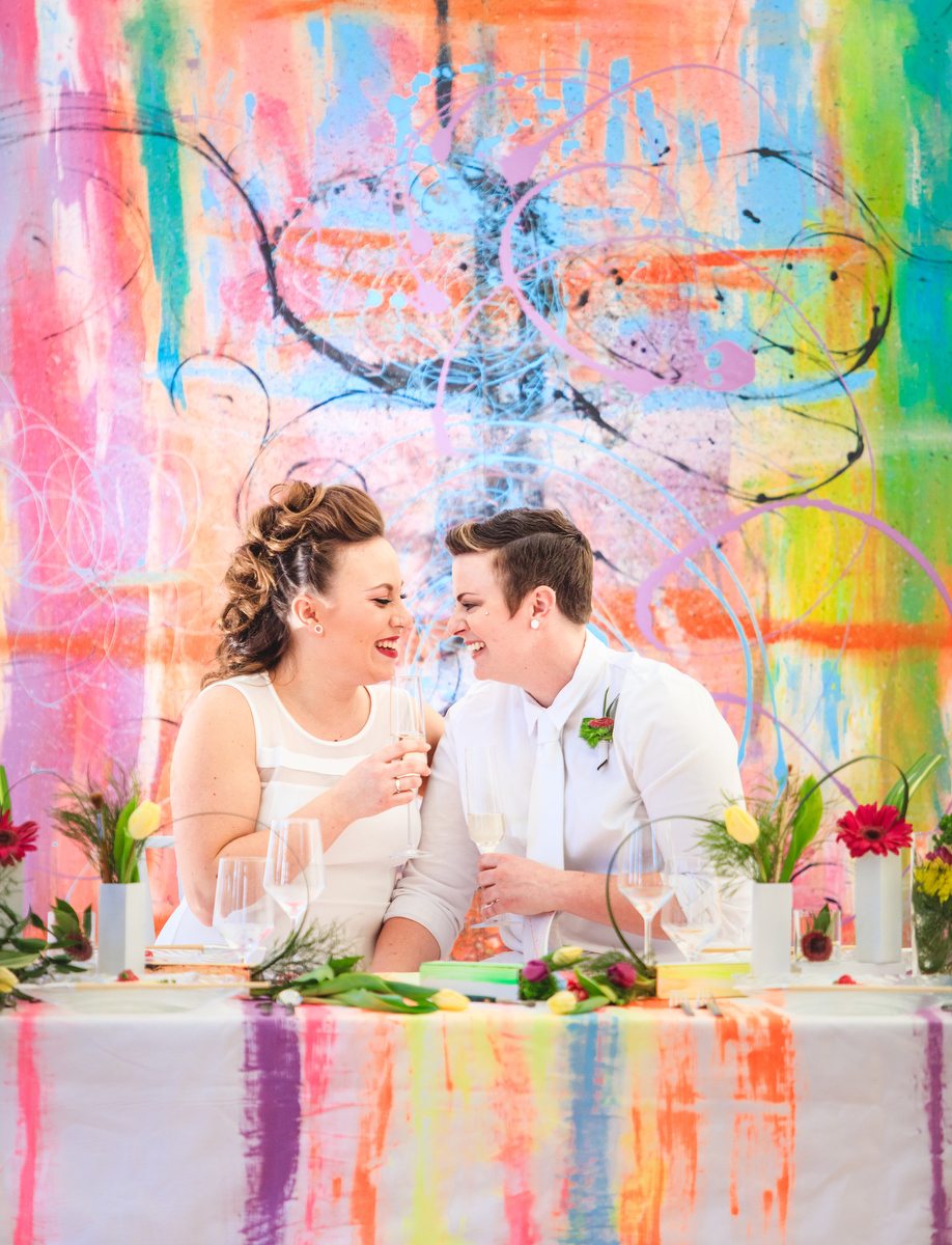 Love Out Loud Parker Colorado Styled Shoot couple smiling and holding champagne