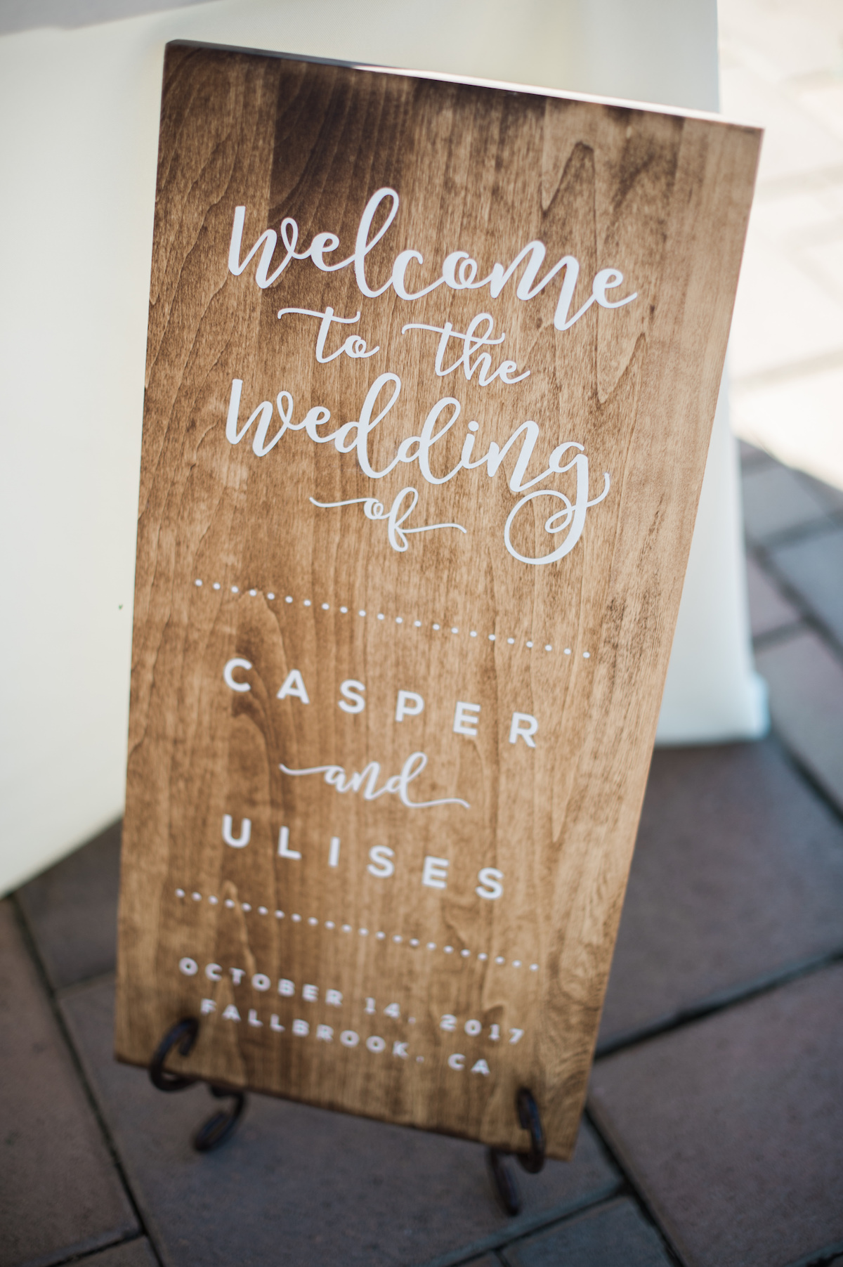 "circle oak ranch farm wedding california plank of wood reading ""welcome to the wedding of casper and ulises, October 14, 2017, fallbrook, ca"""