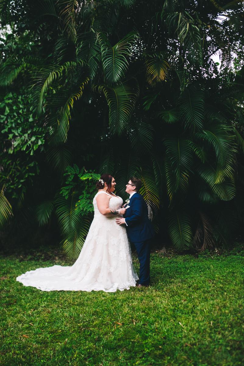fairytale garden wedding vero beach florida candid of couple under trees in garden