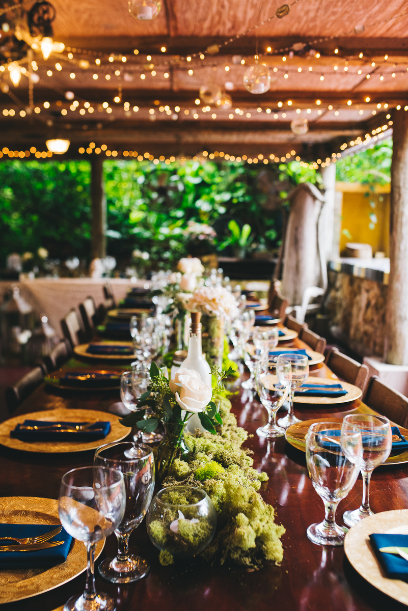 fairytale garden wedding vero beach florida long guest table with moss, flower, and wine bottle decorations