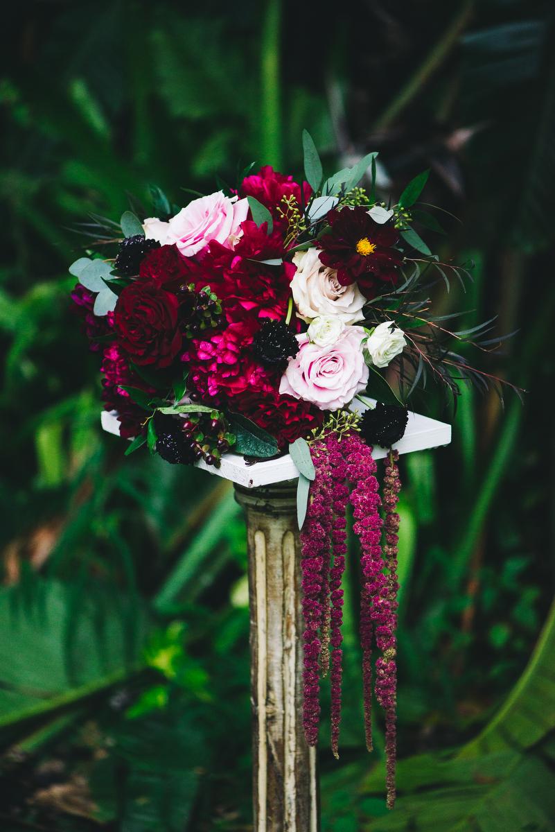 fairytale garden wedding vero beach florida samantha's bouquet on stone pedestal