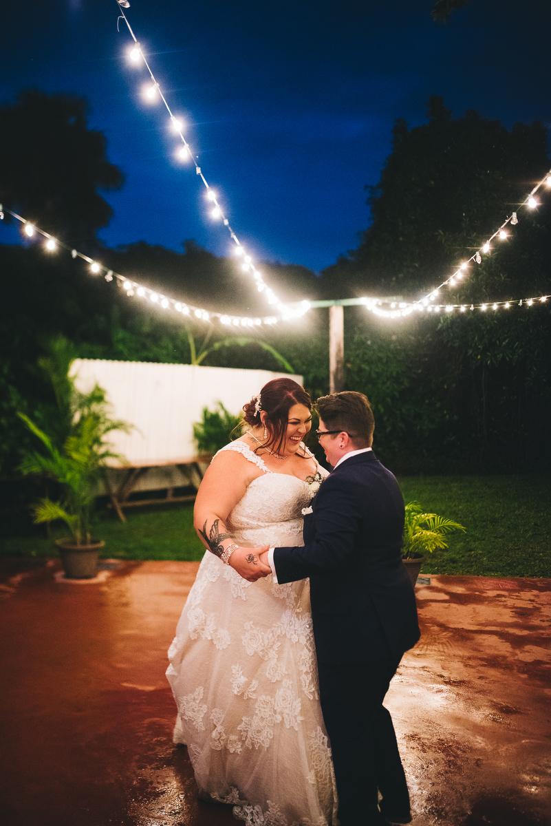 fairytale garden wedding vero beach florida couple dancing under strings of lights on garden patio