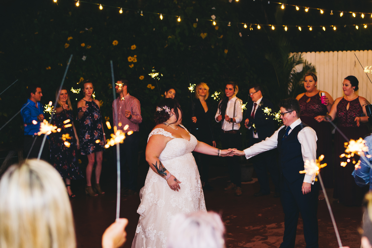 fairytale garden wedding vero beach florida couple dancing with guests holding sparklers