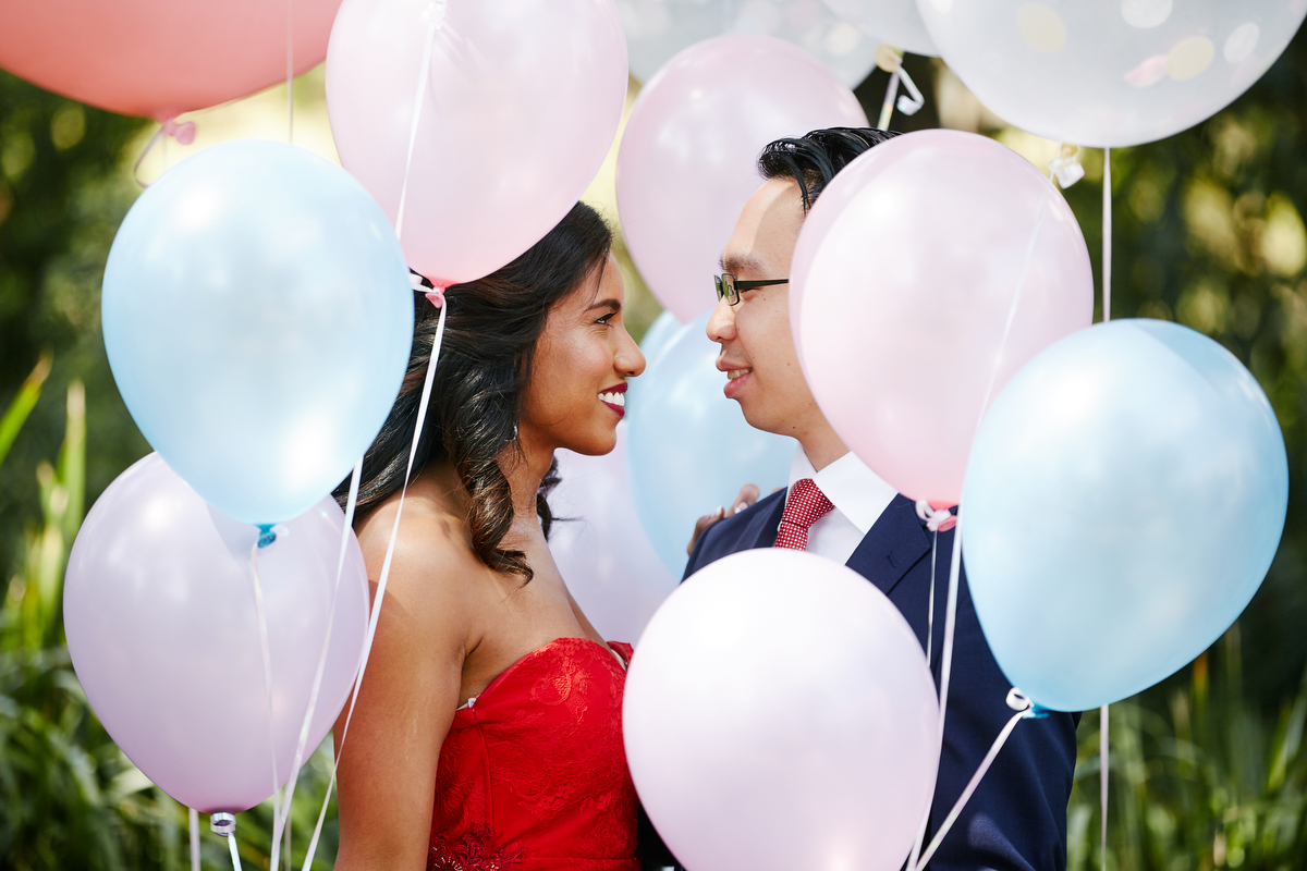 sri lankan, chinese, and harry potter wedding sydney australia couple smiling at one another surrounded by balloons