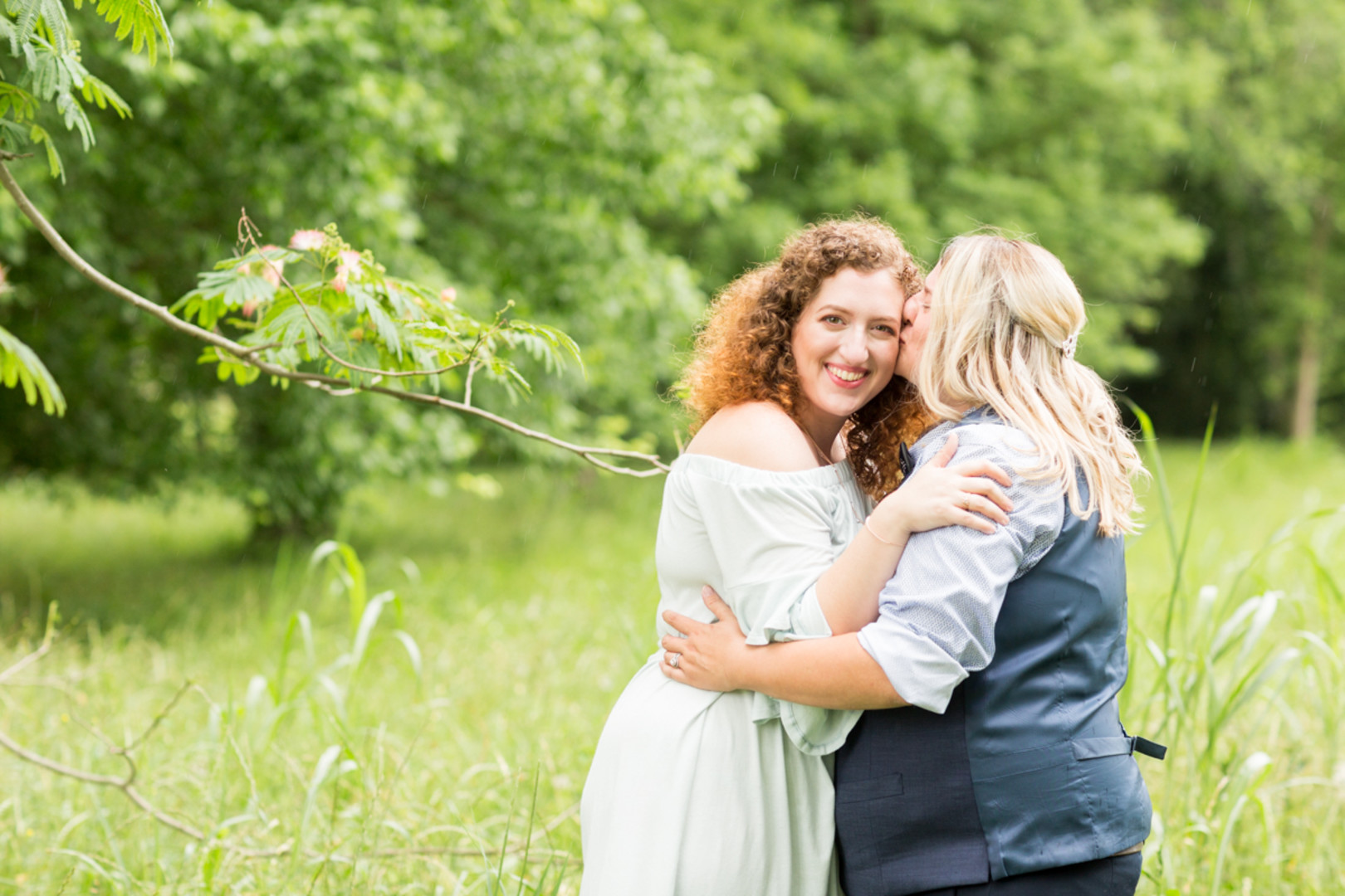 LGBTQ newlywed portraits in a field kissing on cheek columbia south carolina jessica hunt photography