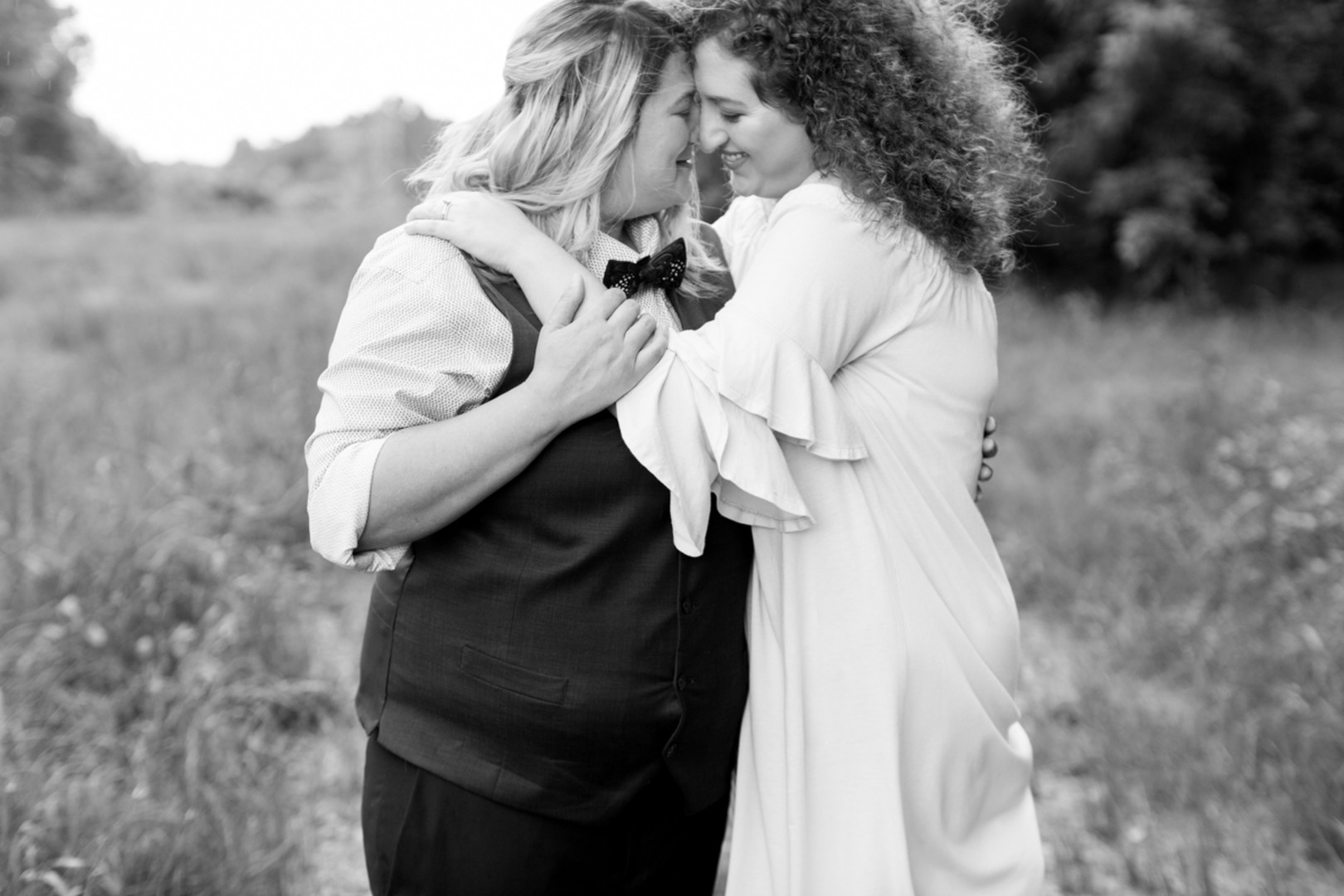 LGBTQ brides embraced in field newlywed portraits columbia south carolina jessica hunt photography