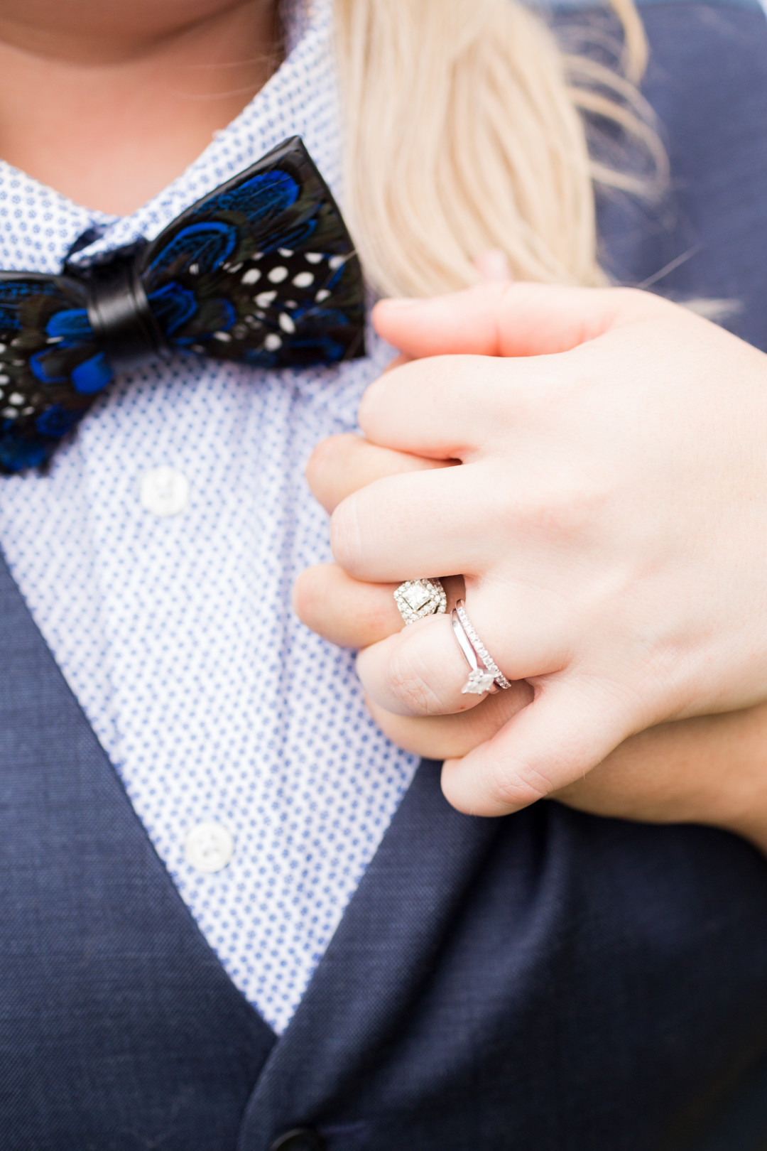 LGBTQ brides holding hands with rings newlywed portraits columbia south carolina jessica hunt photography
