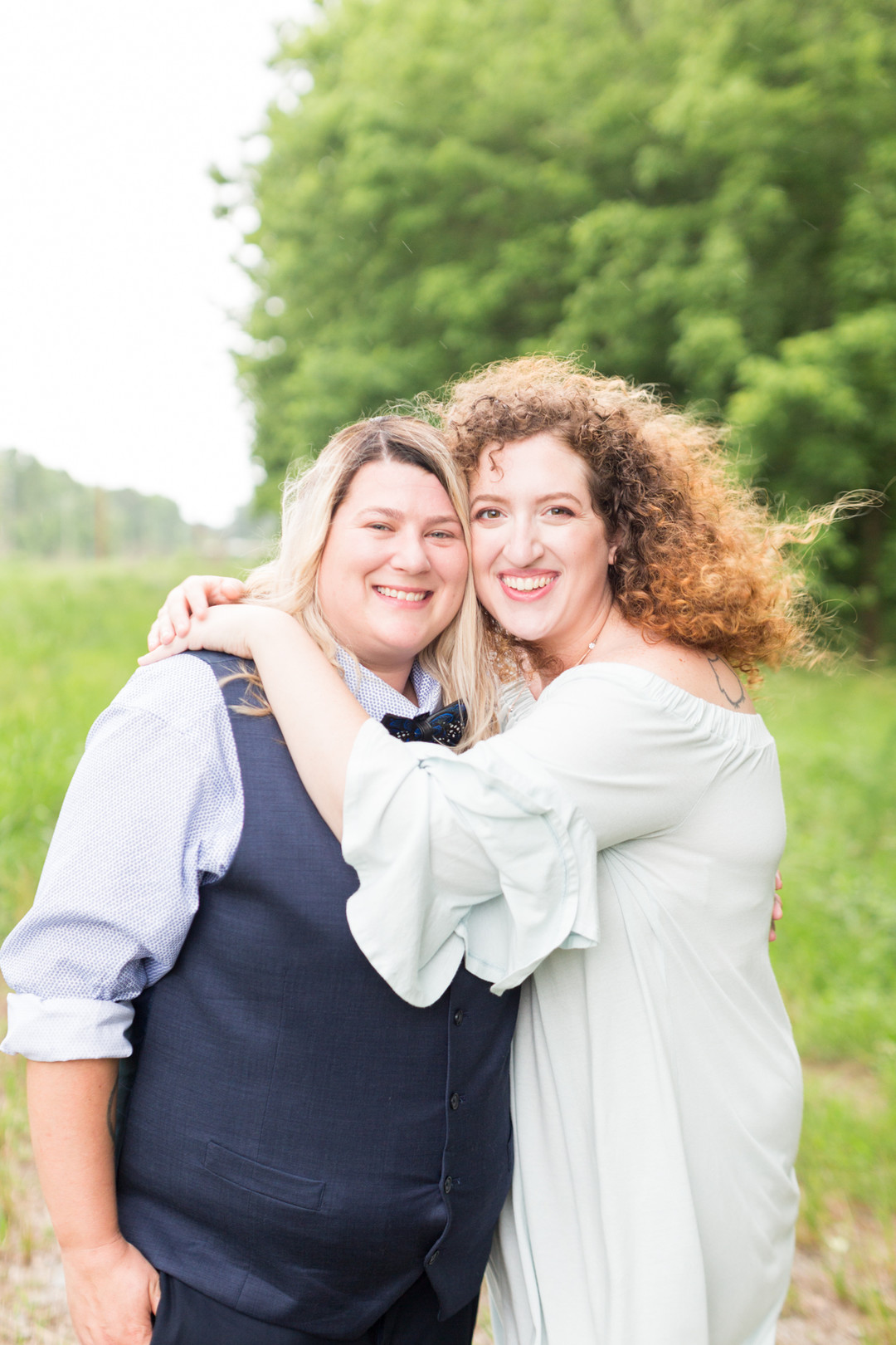 two brides hug in field newlywed portrait columbia south carolina jessica hunt photography
