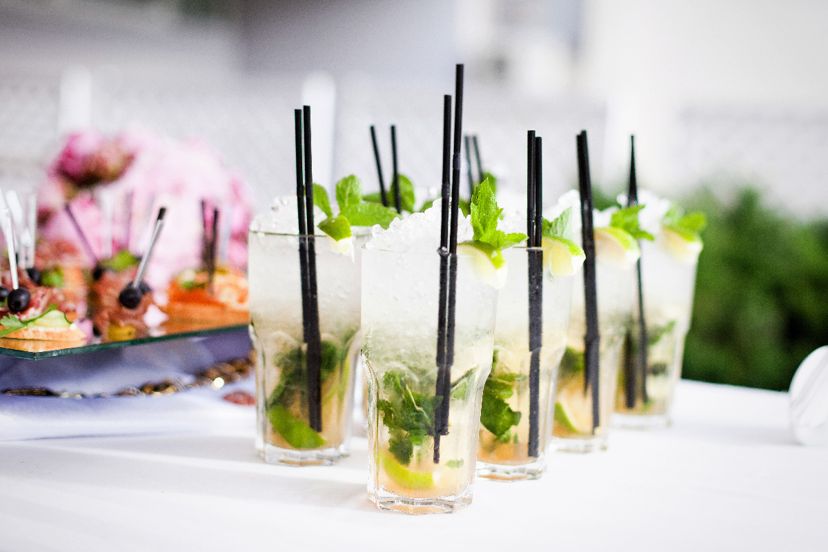 Cocktails with plastic straws at wedding reception