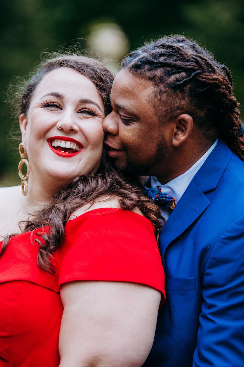 engagement photo shoot at akron art museum gio kissing alysse's cheek