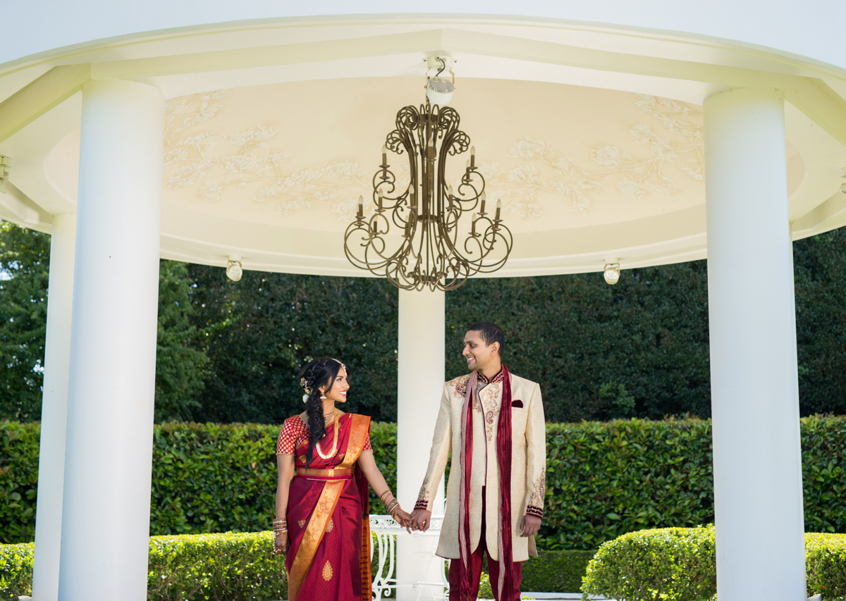 sri lankan wedding in sydney australia couple holding hands under gazebo