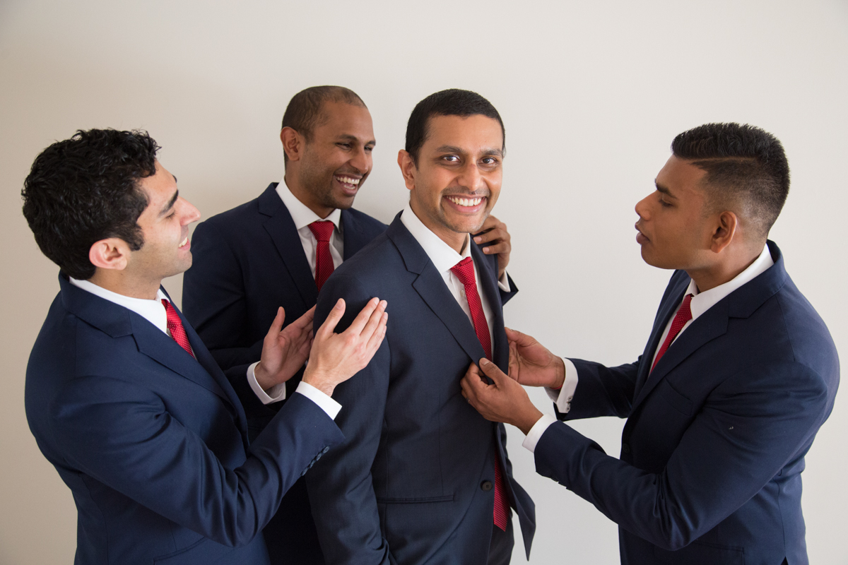 sri lankan wedding in sydney australia groom getting help with jacket from groomsmen