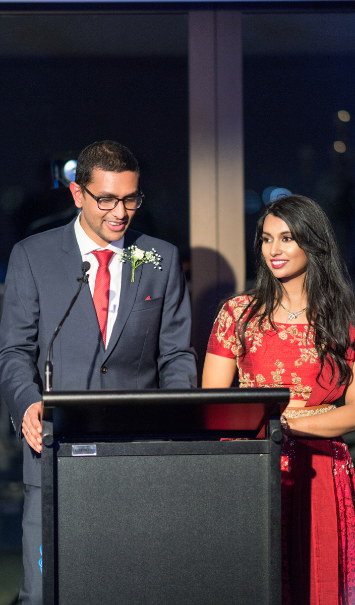 sri lankan wedding in sydney australia abirami and dilshan at podium during reception