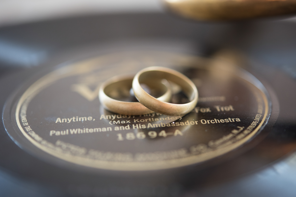 vintage wedding editorial at the art factory paterson new jersey rings on vinyl record