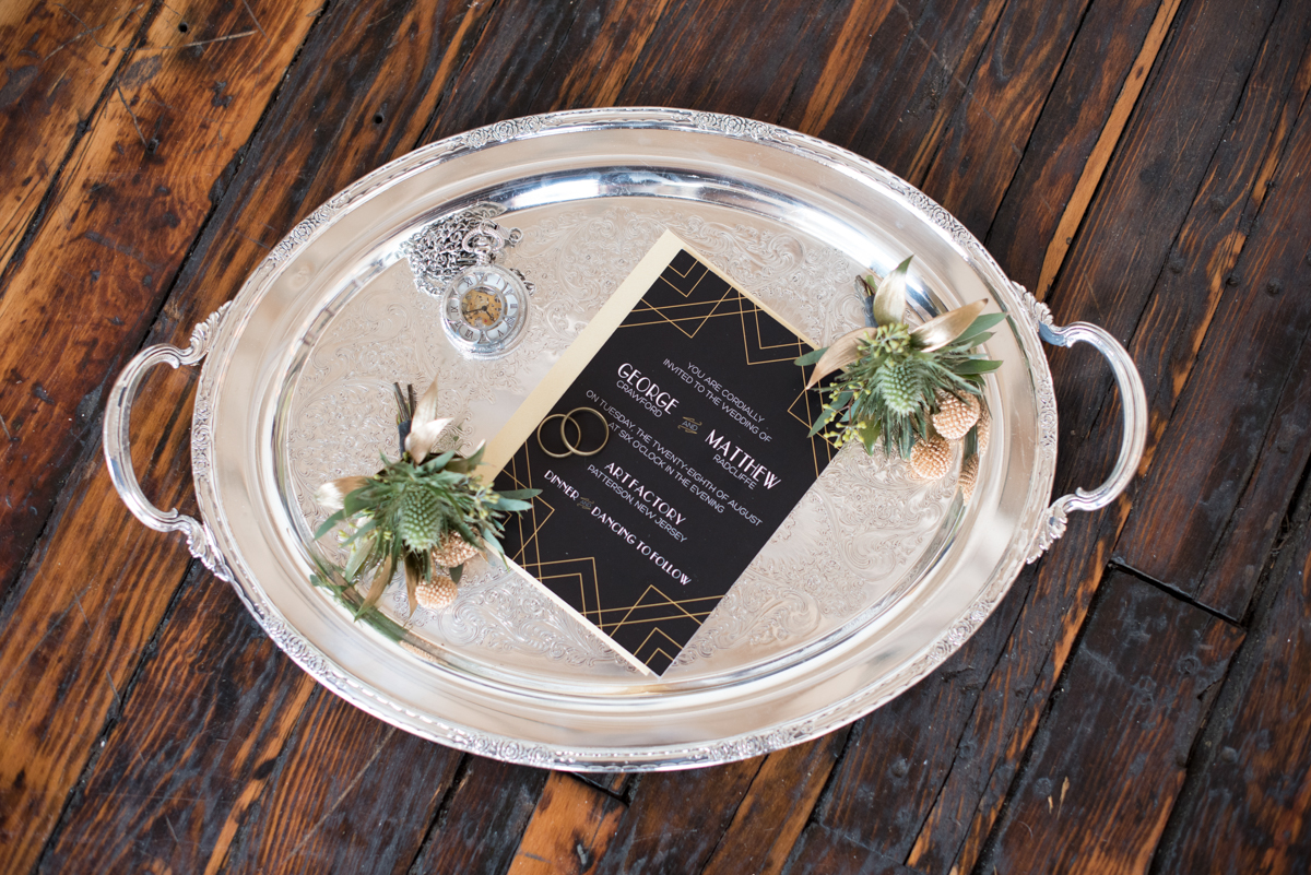 vintage wedding editorial at the art factory paterson new jersey silver tray with invitation, BOUTONNIERES, rings, and pocket watch