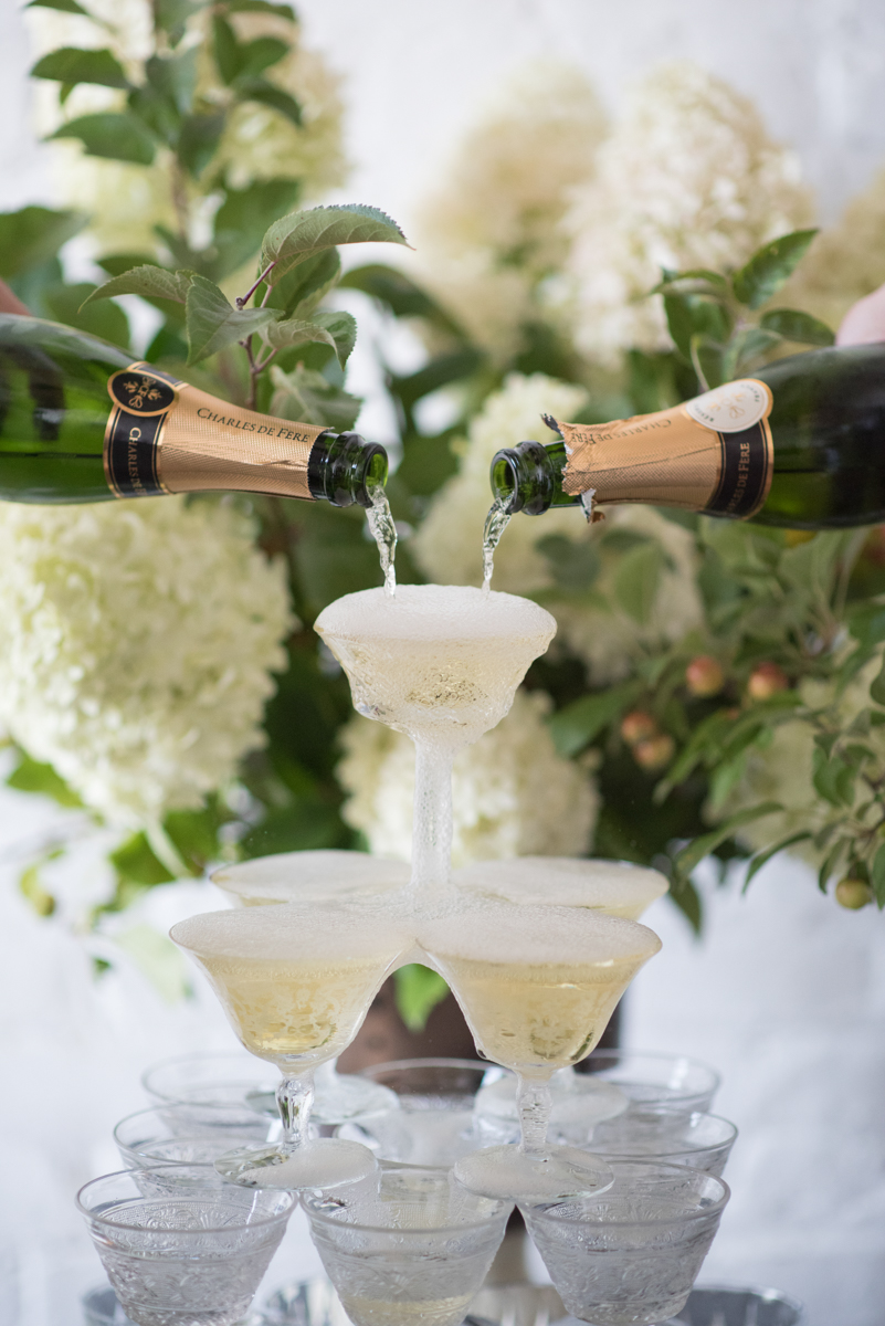 vintage wedding editorial at the art factory paterson new jersey champagne filling glass tower