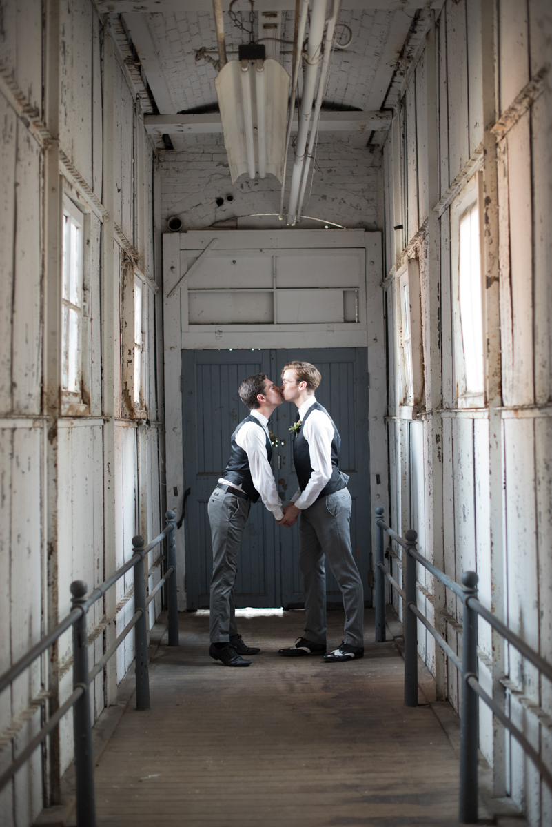 vintage wedding editorial at the art factory paterson new jersey kiss in hallway