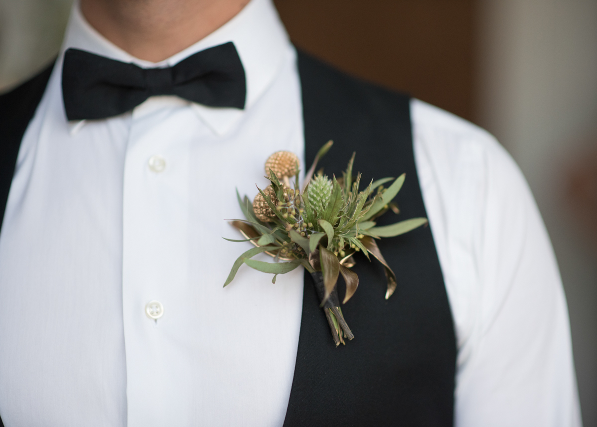 vintage wedding editorial at the art factory paterson new jersey matt's boutonniere on vest