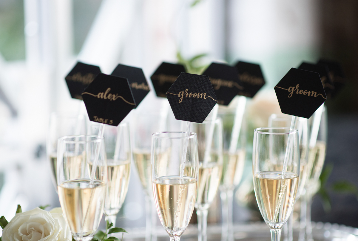 vintage wedding editorial at the art factory paterson new jersey champagne glasses with name cards on straws