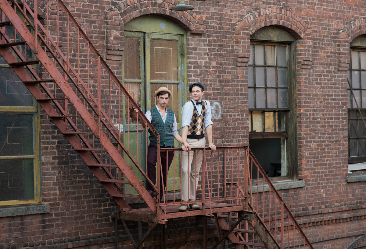 vintage wedding editorial at the art factory paterson new jersey couple on fire escape wearing casual vintage outfits