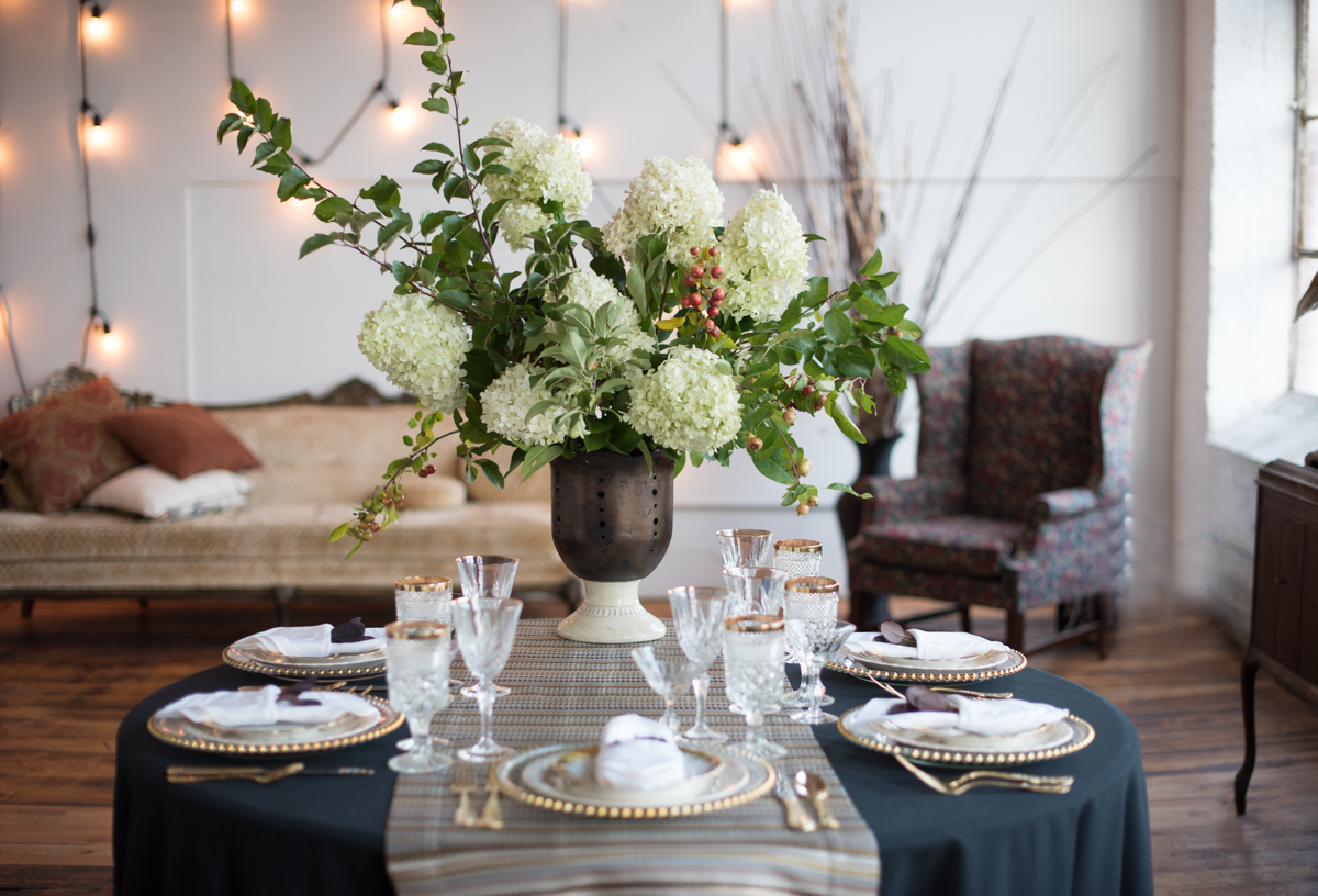 vintage wedding editorial at the art factory paterson new jersey table with large floral centerpiece