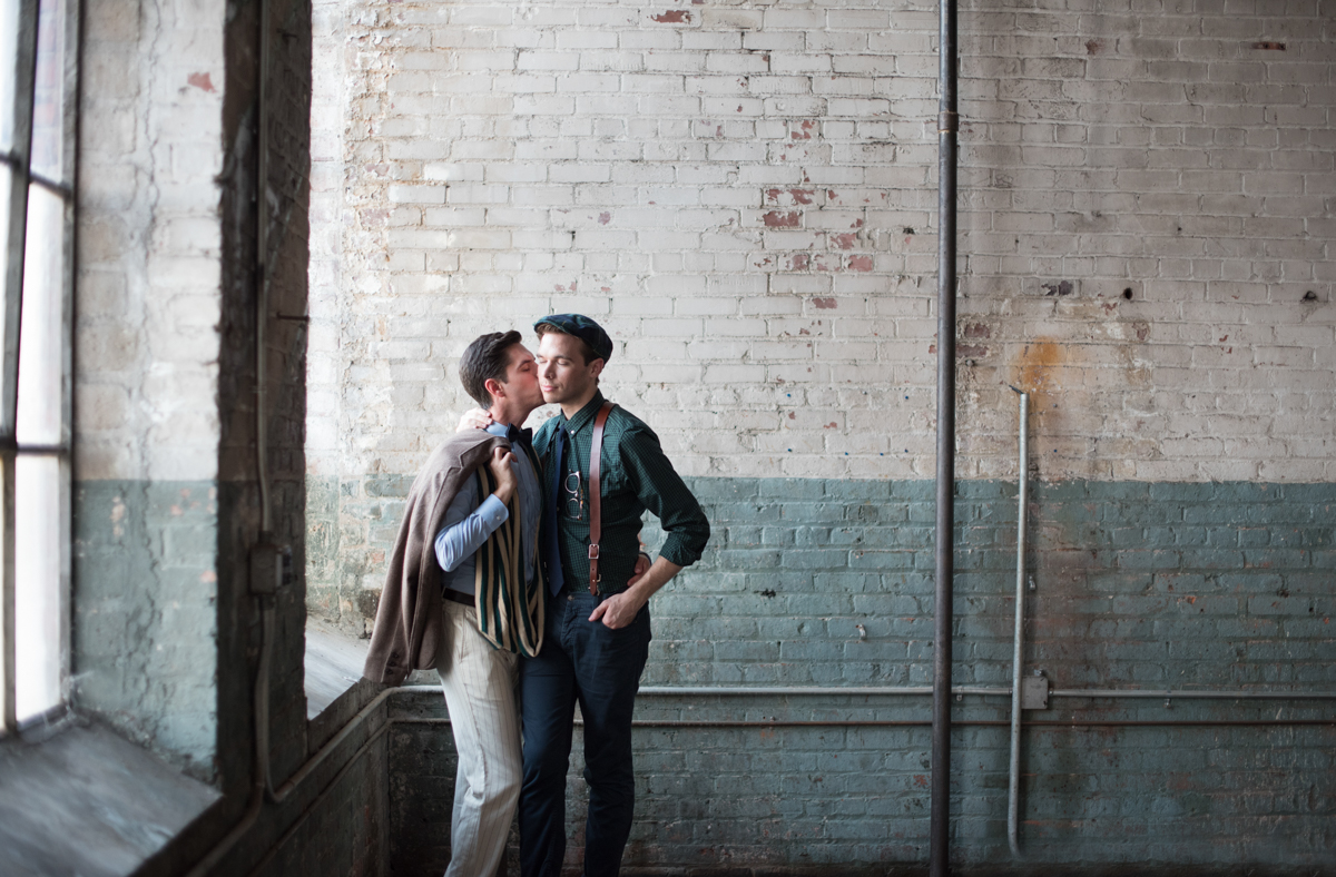 vintage wedding editorial at the art factory paterson new jersey matt kissing george's cheek by window